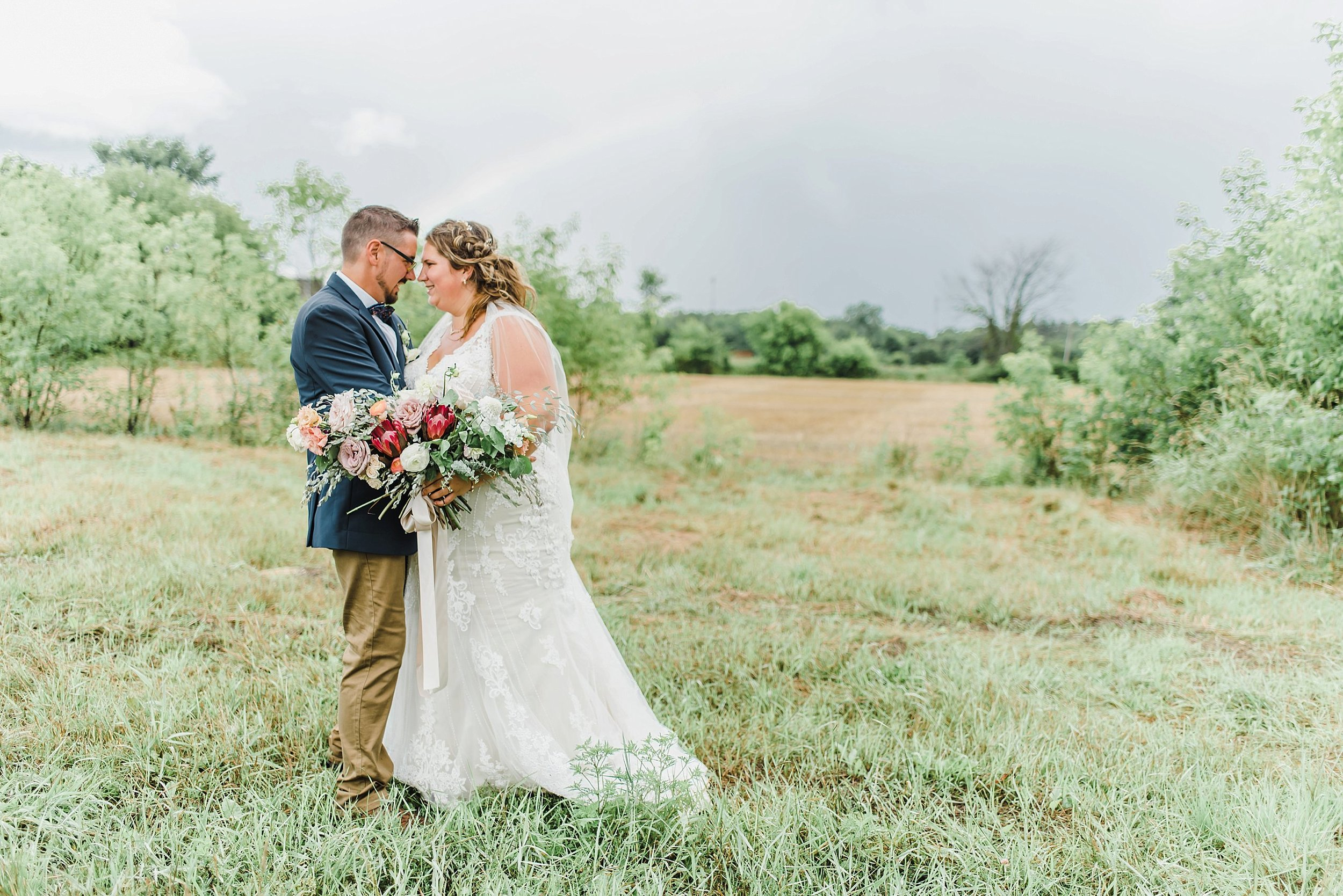 Because of the unpredictable rain throughout the afternoon, we only had a handful of minutes to take Genevieve and Jason's portraits in between downpours!  Here is just some of the beauty we got!