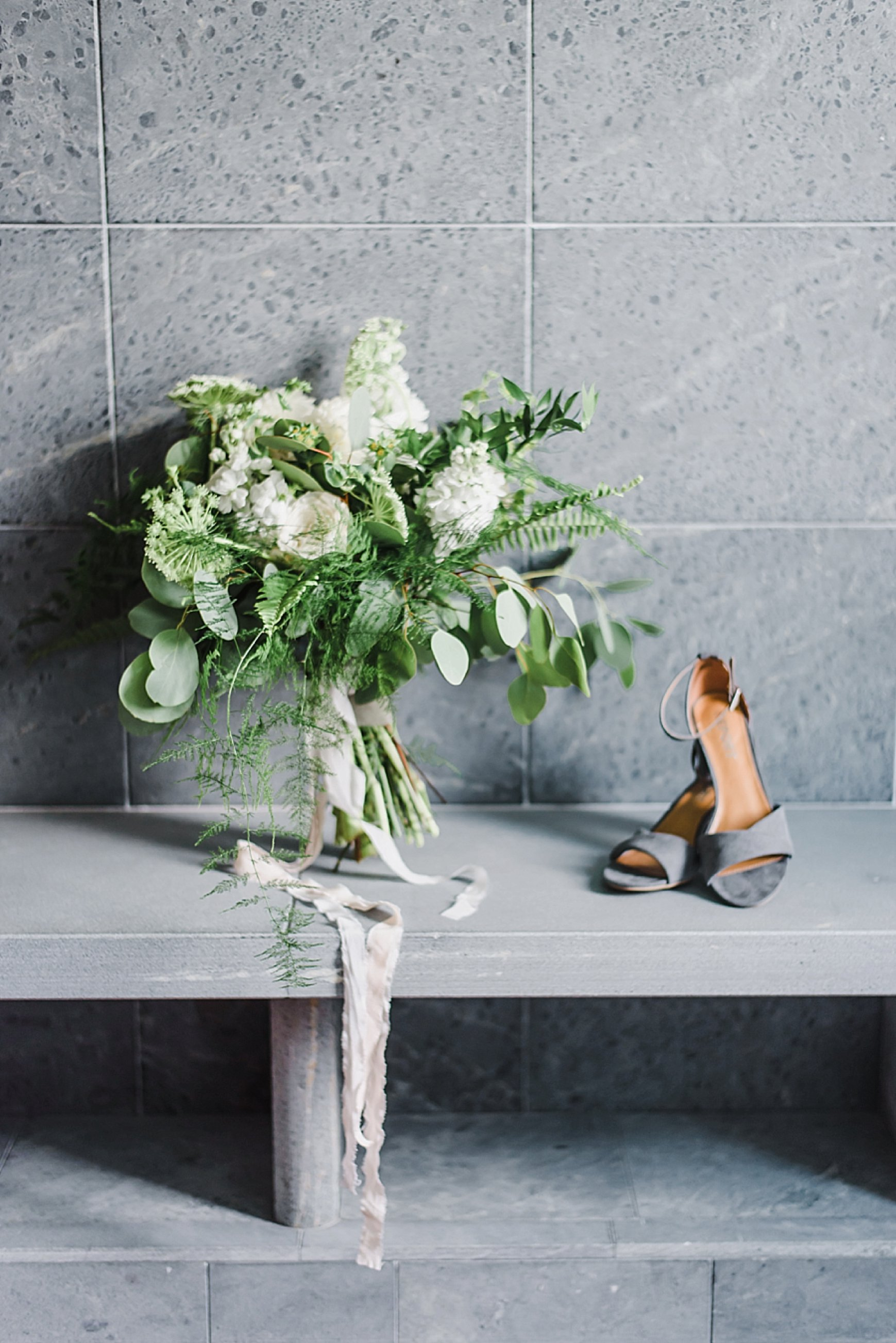 The all white and green garden-inspired bouquet by Jade Gardens blew us all away!