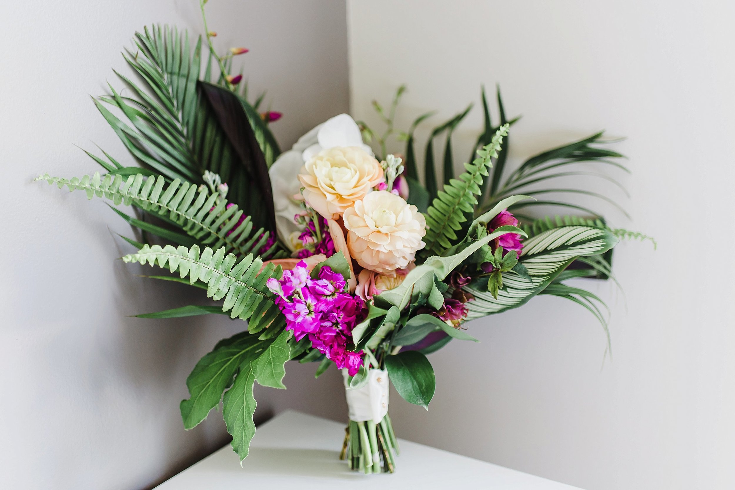 They brought a Caribbean flavour to their wedding design by incorporating tropical greenery and florals to the bridal bouquet.