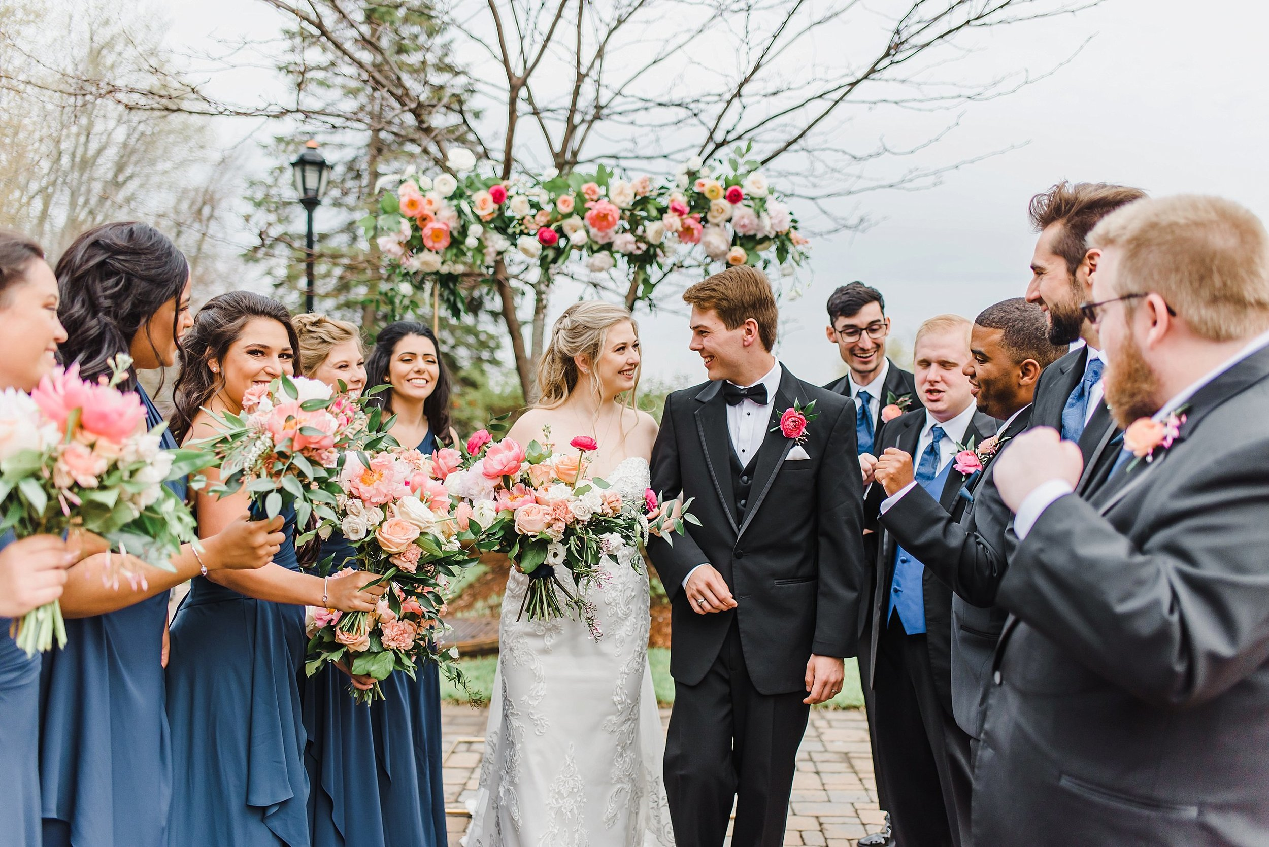 The rain stopped for a few minutes in between the ceremony and reception, so we ran outdoors to get images of the bridal party!