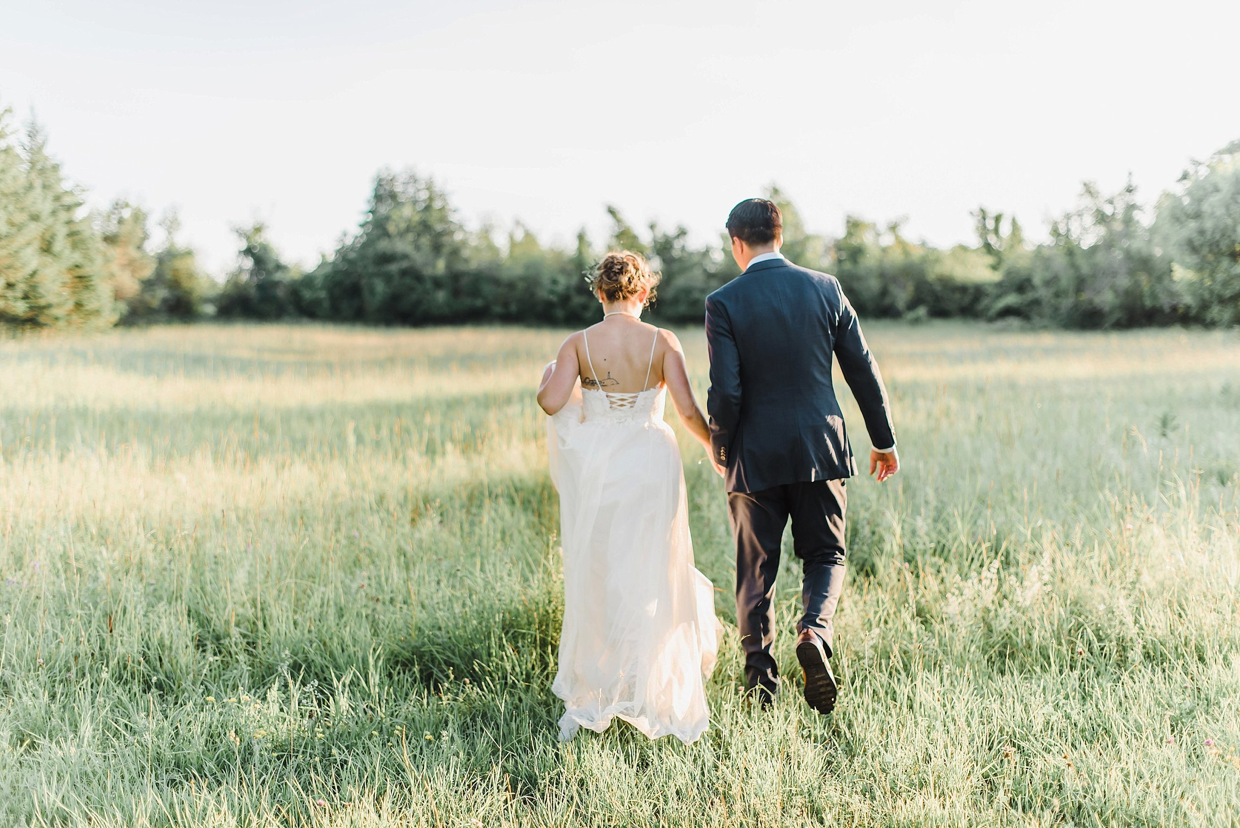 We had a few minutes to run over to the field to capture some golden hour photos before the second portion of the night.  The light was beautiful and made for the most romantic 'just married' photos!