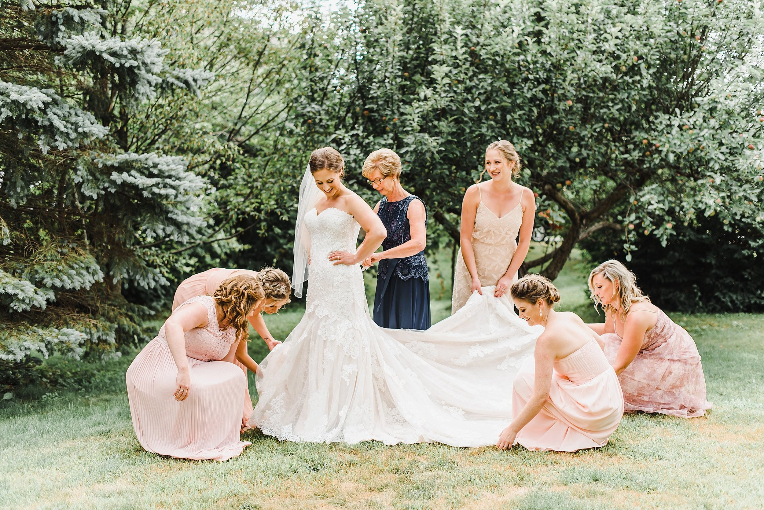 Audra got ready at her parent's home in the country, so we took advantage of their beautiful backyard to capture her 'getting ready' moments with her mom and best friends!