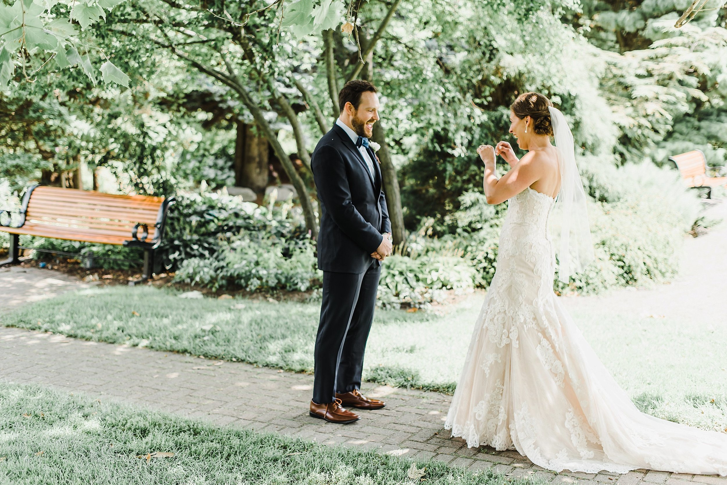 Their first look took place just down the road from their reception space at the Ornamental Gardens.  To say it was an emotional moment is an understatement!