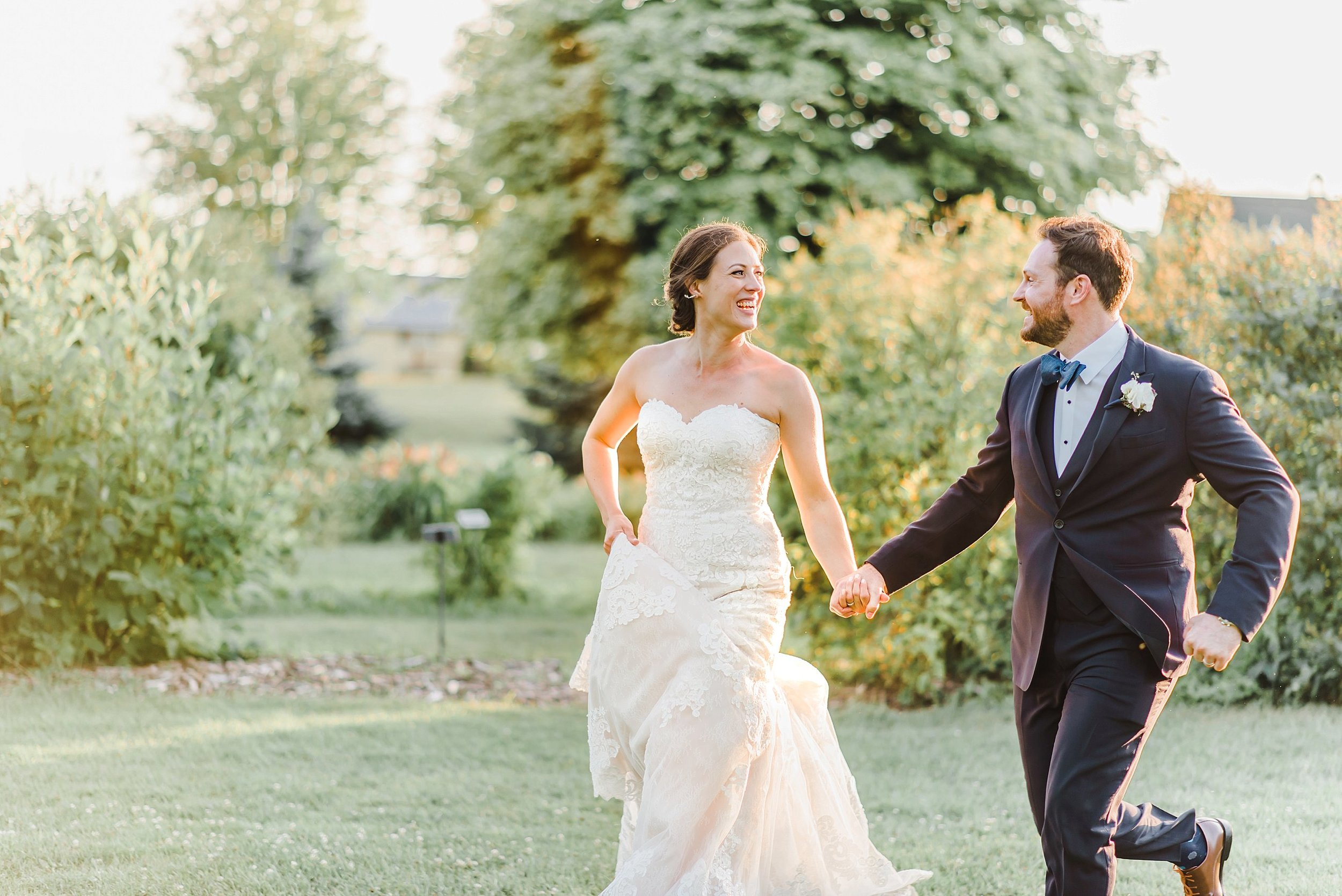 When sunset approached, we had a few minutes to run off on the grounds to capture these fleeting 'just married' moments between the two.  We were blessed with a golden glowy sky.