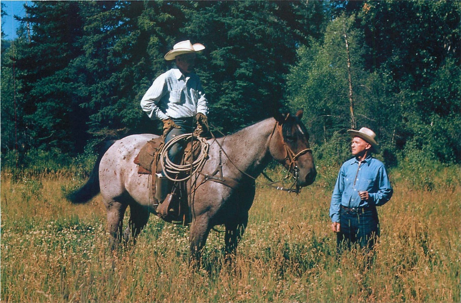 Bruce (right) talking with the ranch Foreman.