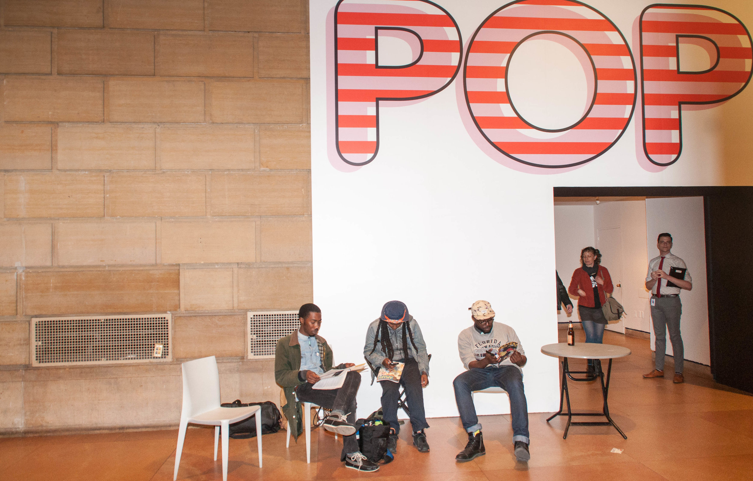 Visitors to the City of Poetry chill outside the museum's pop culture exhibition.