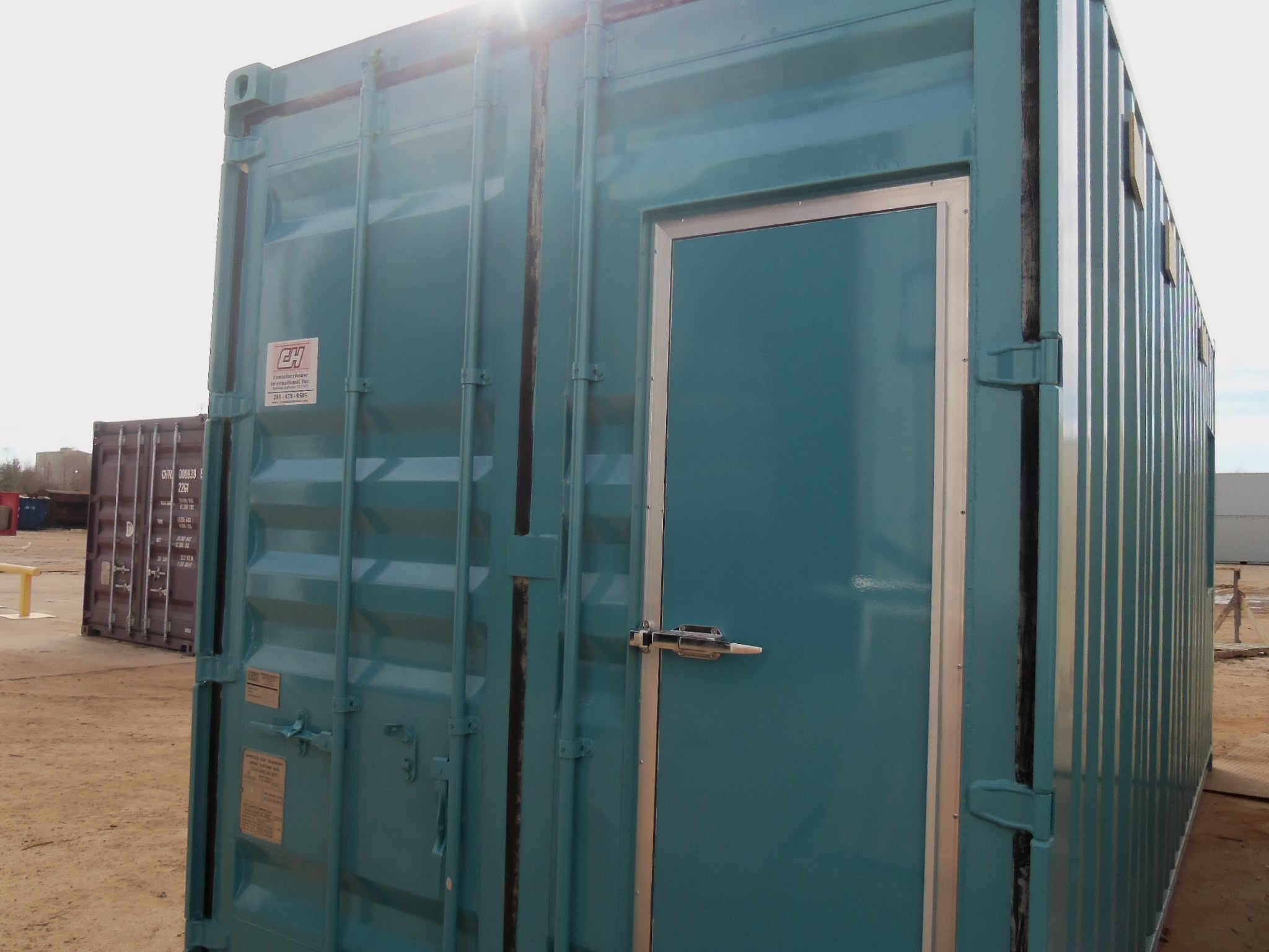 20' high cube ISO container conversion. Customer-provided color code. Tidalwave™ door-in-door™.