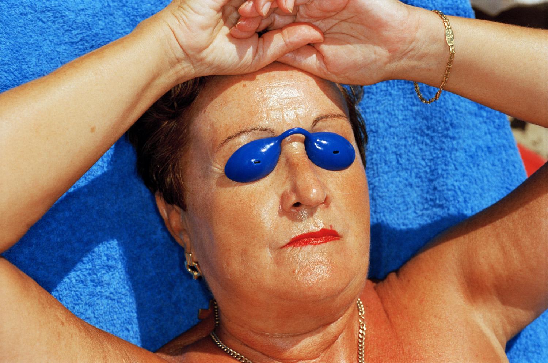 martin-parr-common-sense-woman-sunbathing-spain-1997.jpg