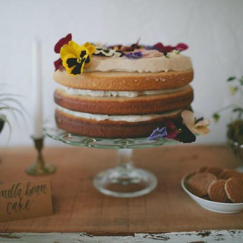 three inch layers of naked vanilla bean cake + fresh pansies and violas