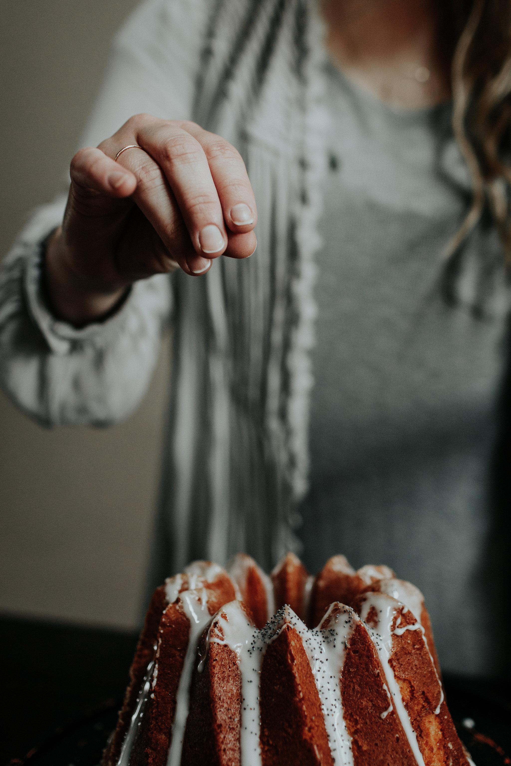 vanilla bean cake + honey whiskey glaze, garnished with poppy seeds.