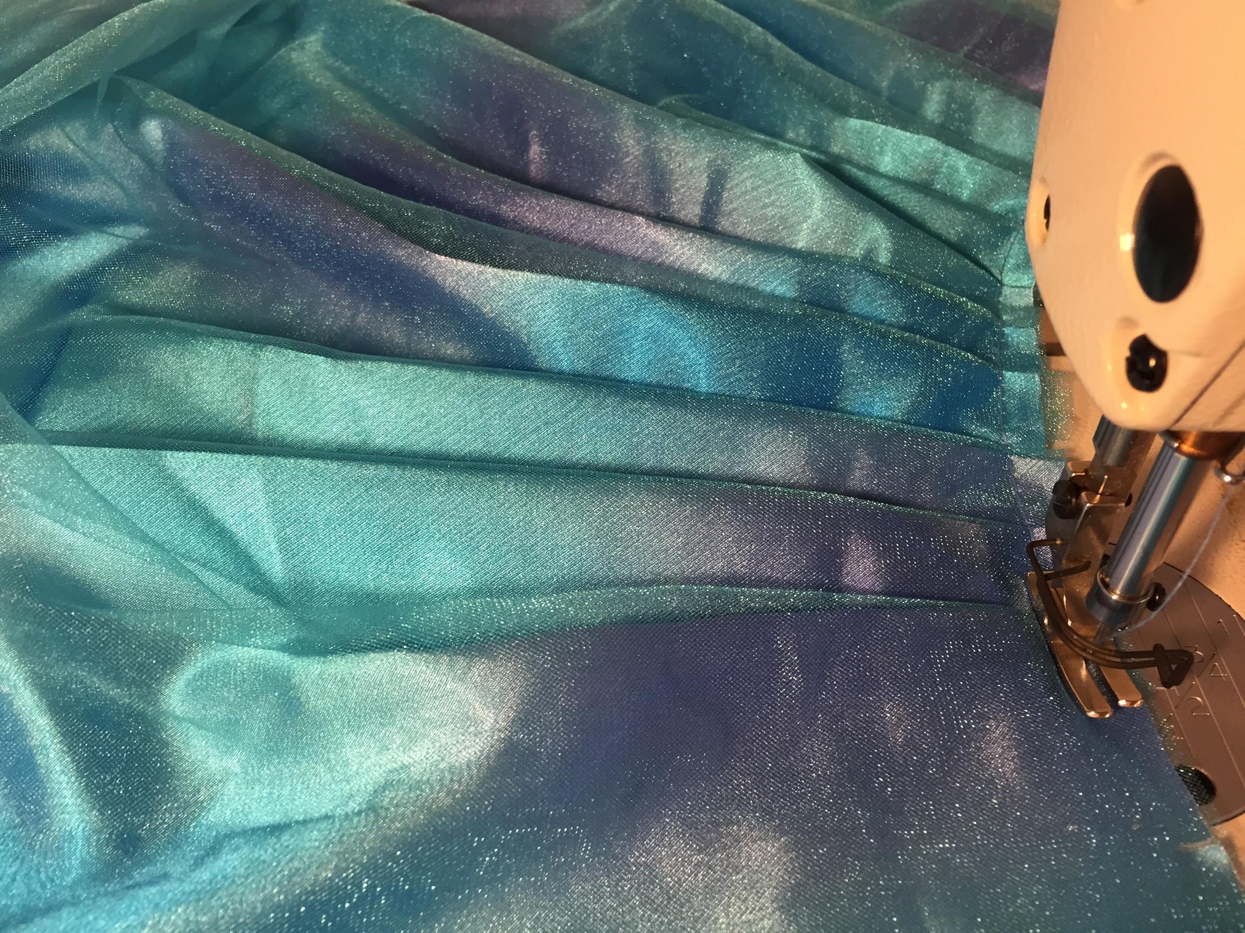 Pleated skirt to reduce fullness, while maximizing twirl power