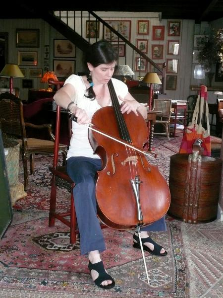 Louise playing Franchomme's practice cello, at the house of Thierry (last name removed for privacy reasons), its owner.