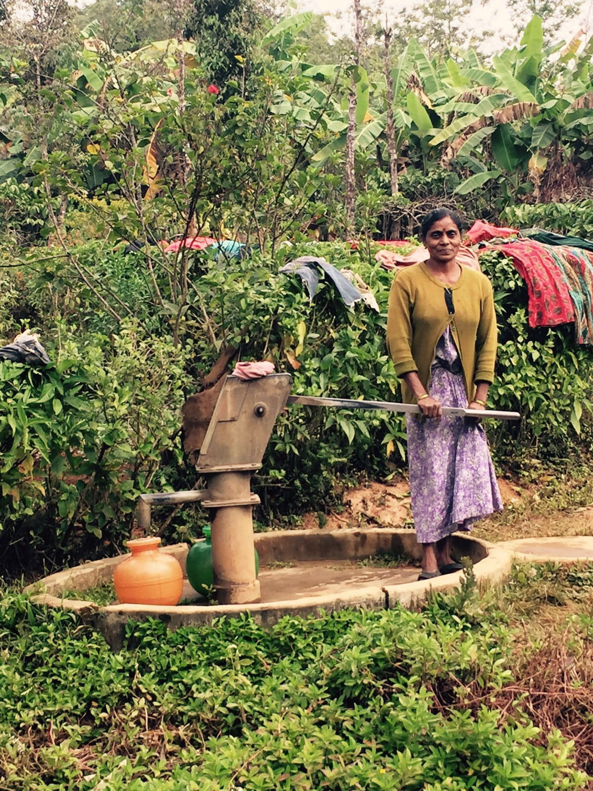 Woman pumping water from the Kaveri River