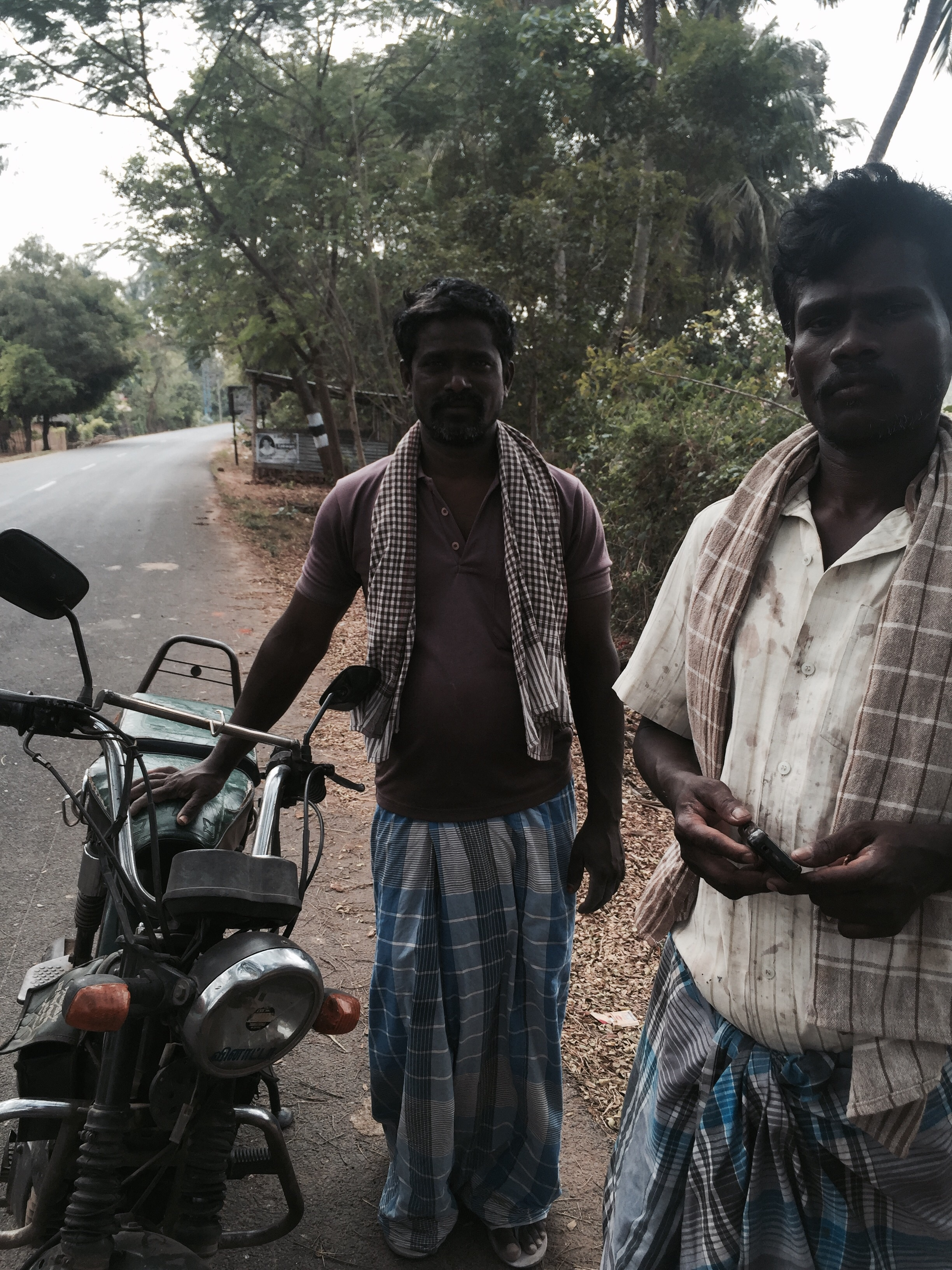 The man holding the motorbike is the guy who delivered me the goods!