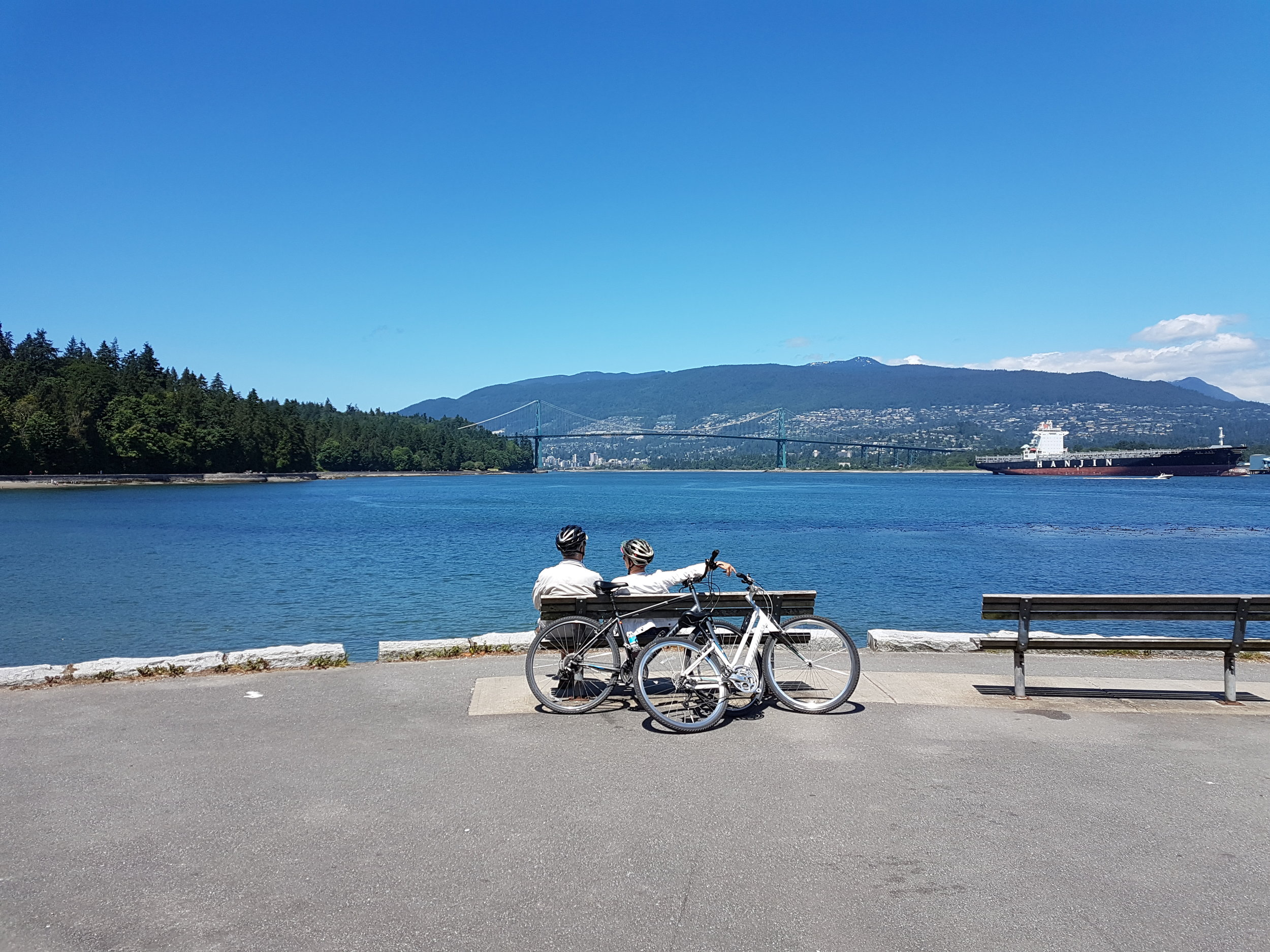 Cycling along the Sea Wall in Stanley Park during our Vancouver City Tour