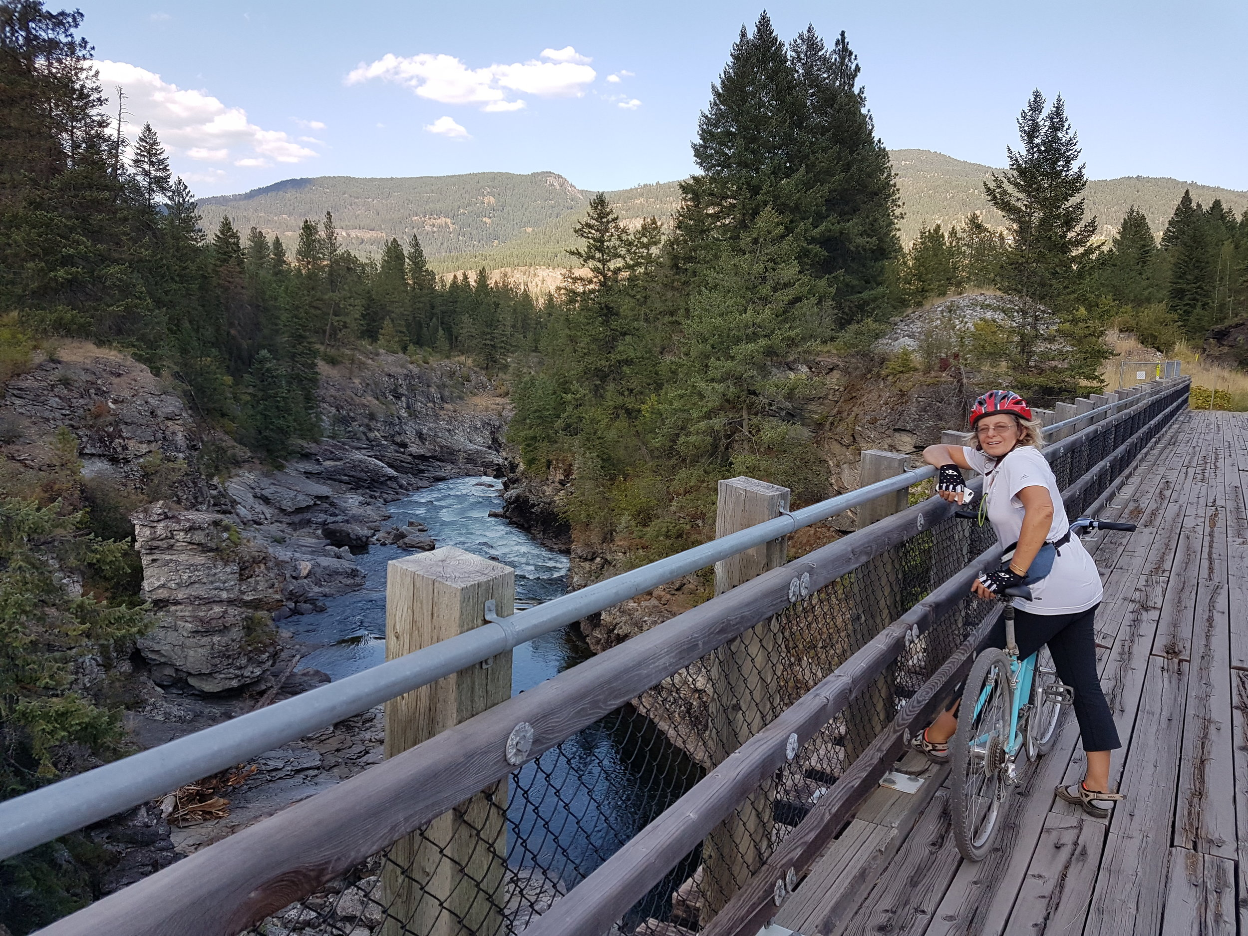 Crosing the Kettle River on the Columbia and Western Rail Trail during one of our Multiday bike tours