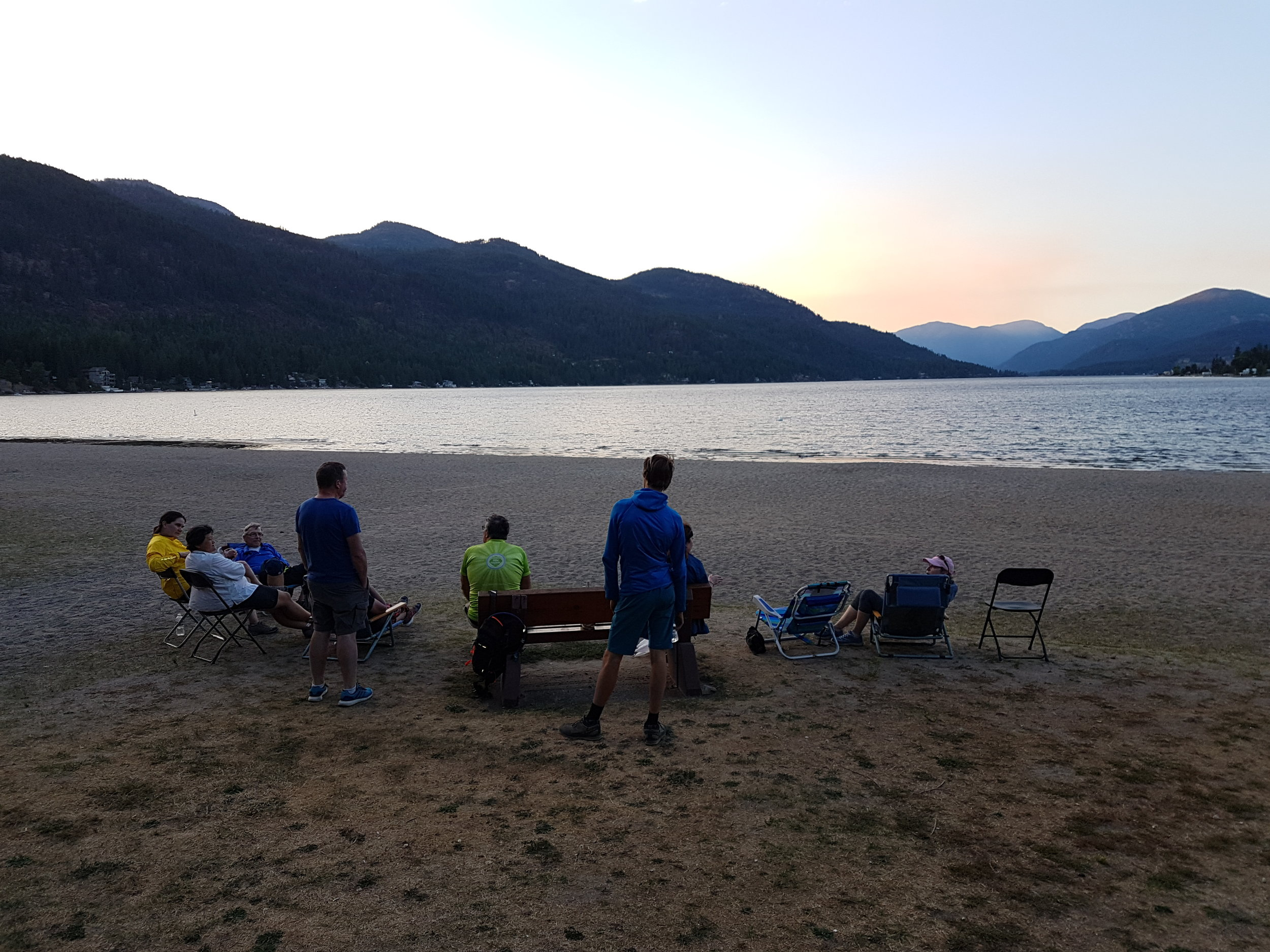 Enjoying the sunset at Christina lake during our multiday bike tours