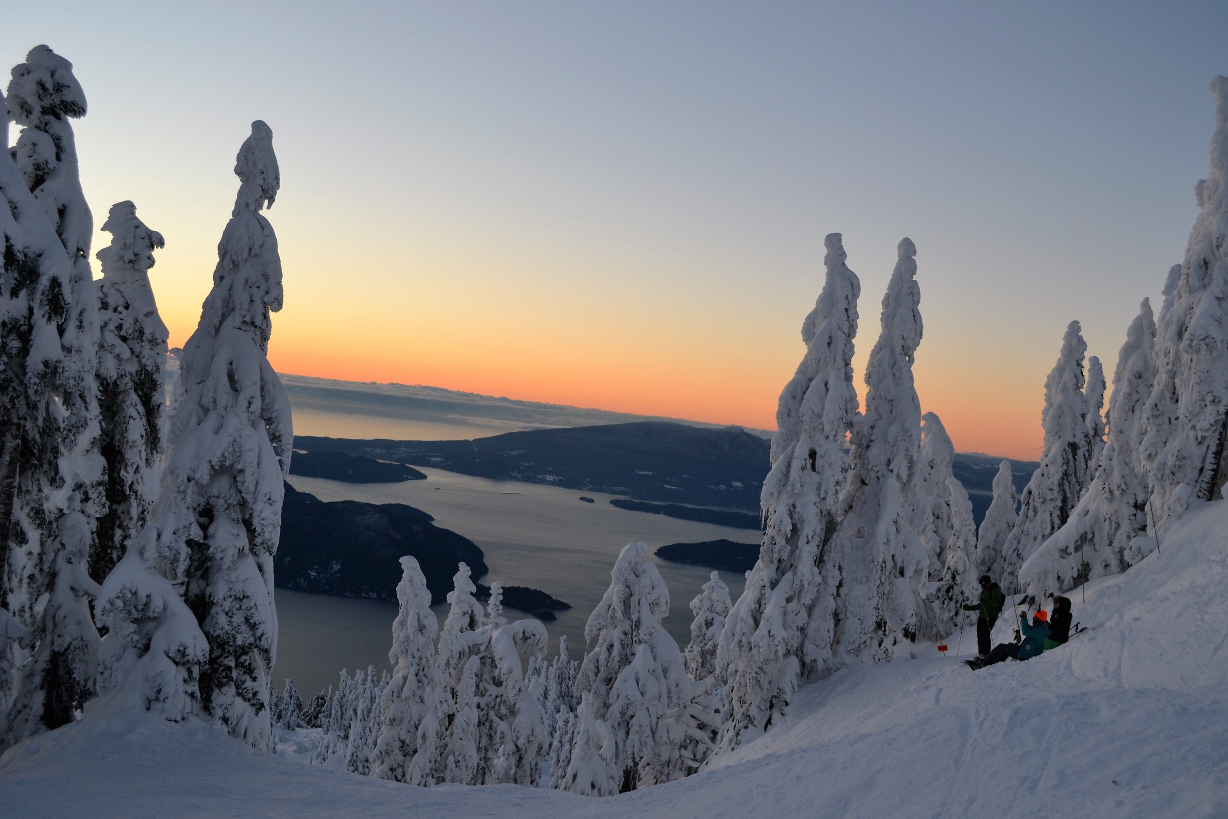 Snowboarders relaxing during sunset in Vancouver