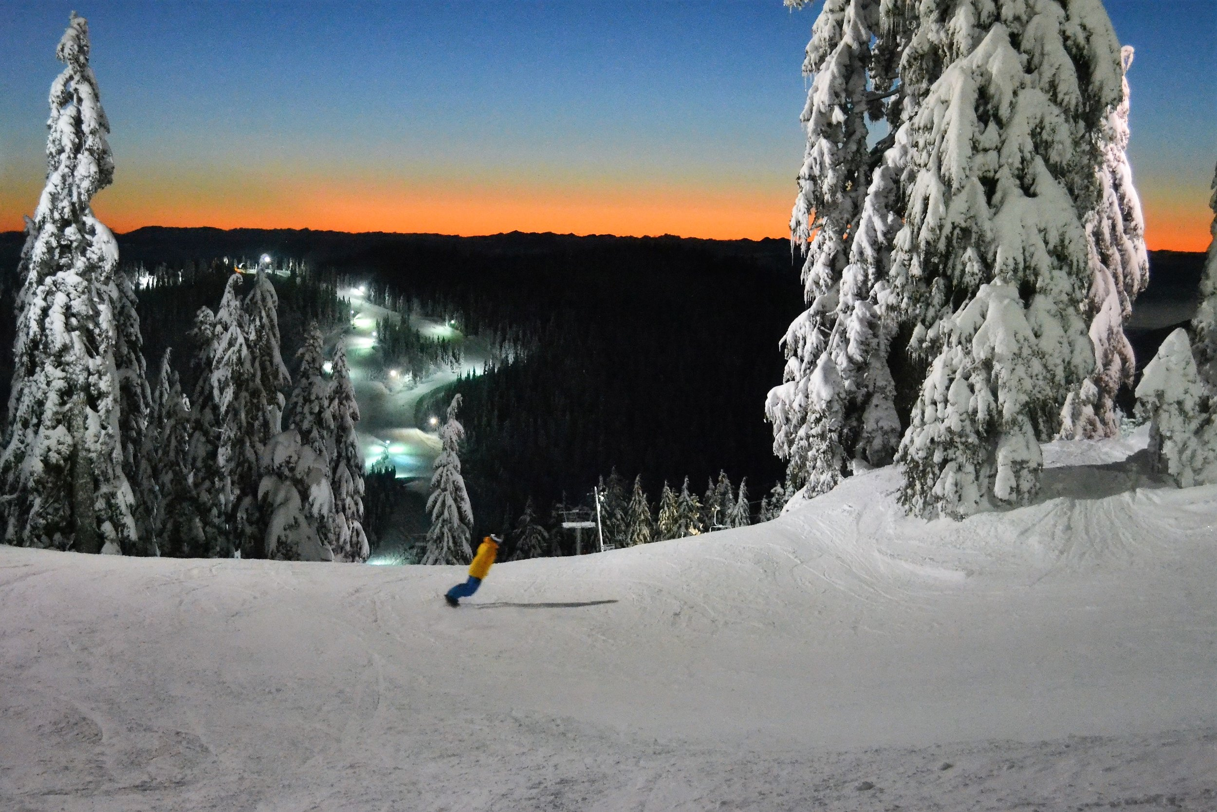 Snowboarder making his way down during a night tour in Vancouver