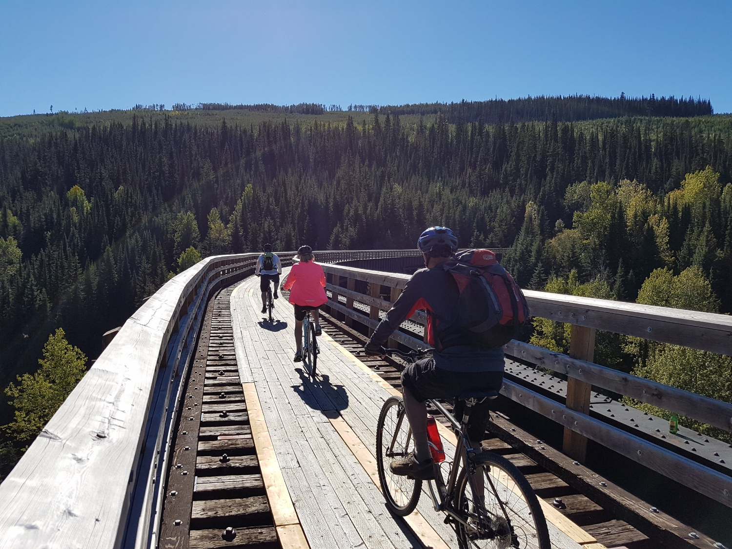 Cycling at Myra Canyon during a bike tour in the Okanagan