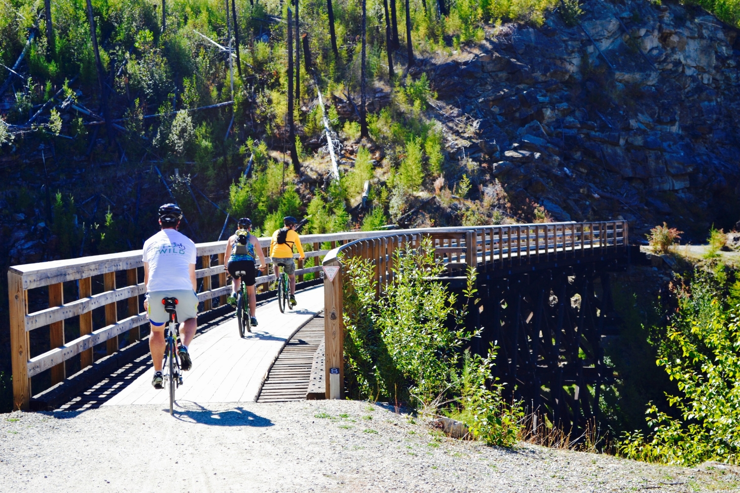 Cycling over a trestle on the KVR at Myra Canyon, British Columbia