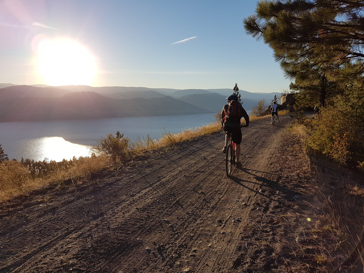 Bike touring along the Okanagan lake on the KVR trail