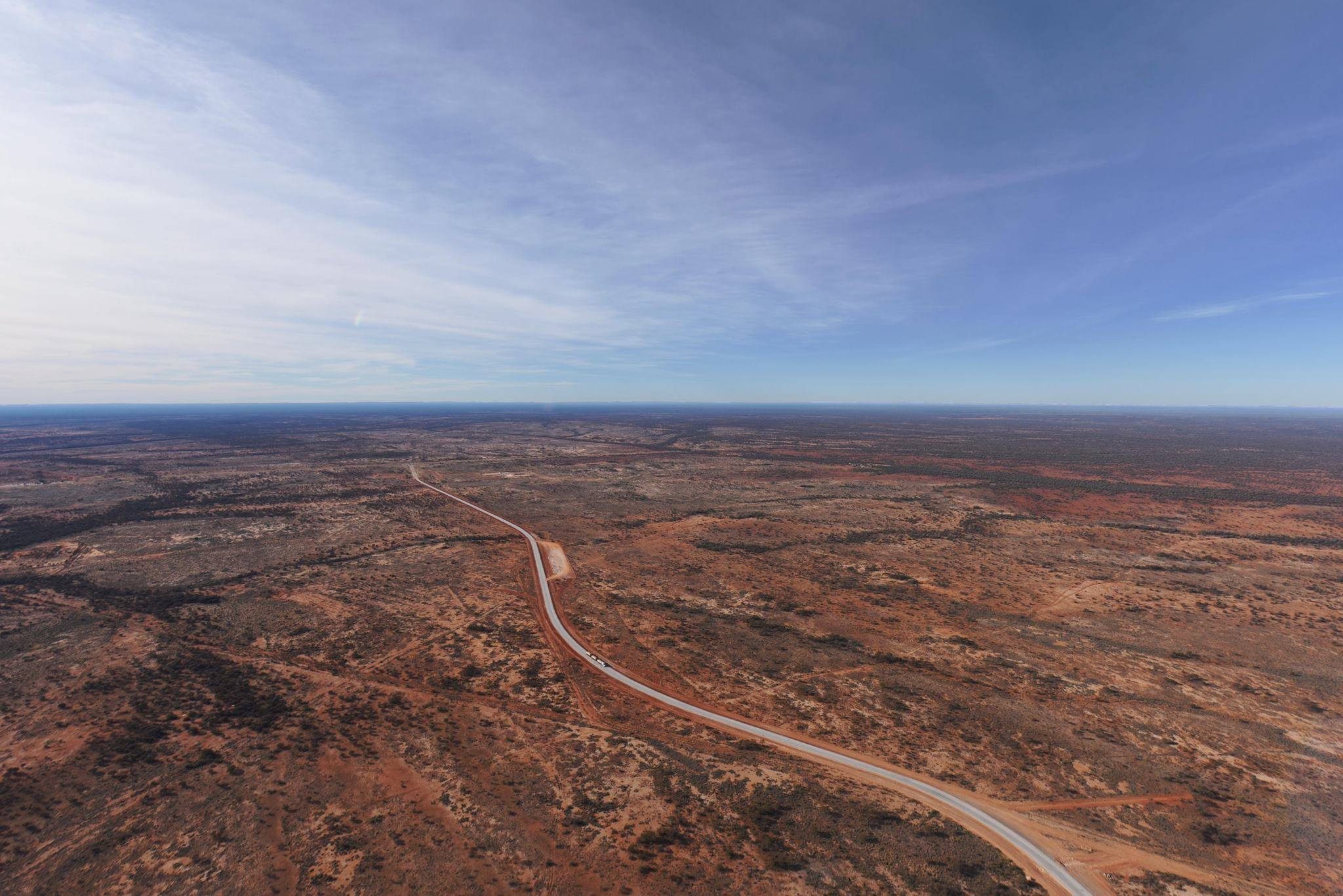 View over the Western Desert from the comfort of a helicopter with its door removed.Photo copyright Kate Ferguson.