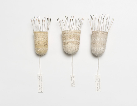 Seed Baskets,  2014. Silver wire, plant-dyed wool, silk and bamboo. Approximately 12 x 4 x 4 cm each.