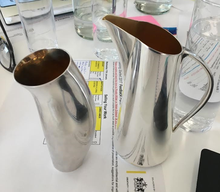Two silver jugs (slightly tarnished thanks to my prolonged stroking)