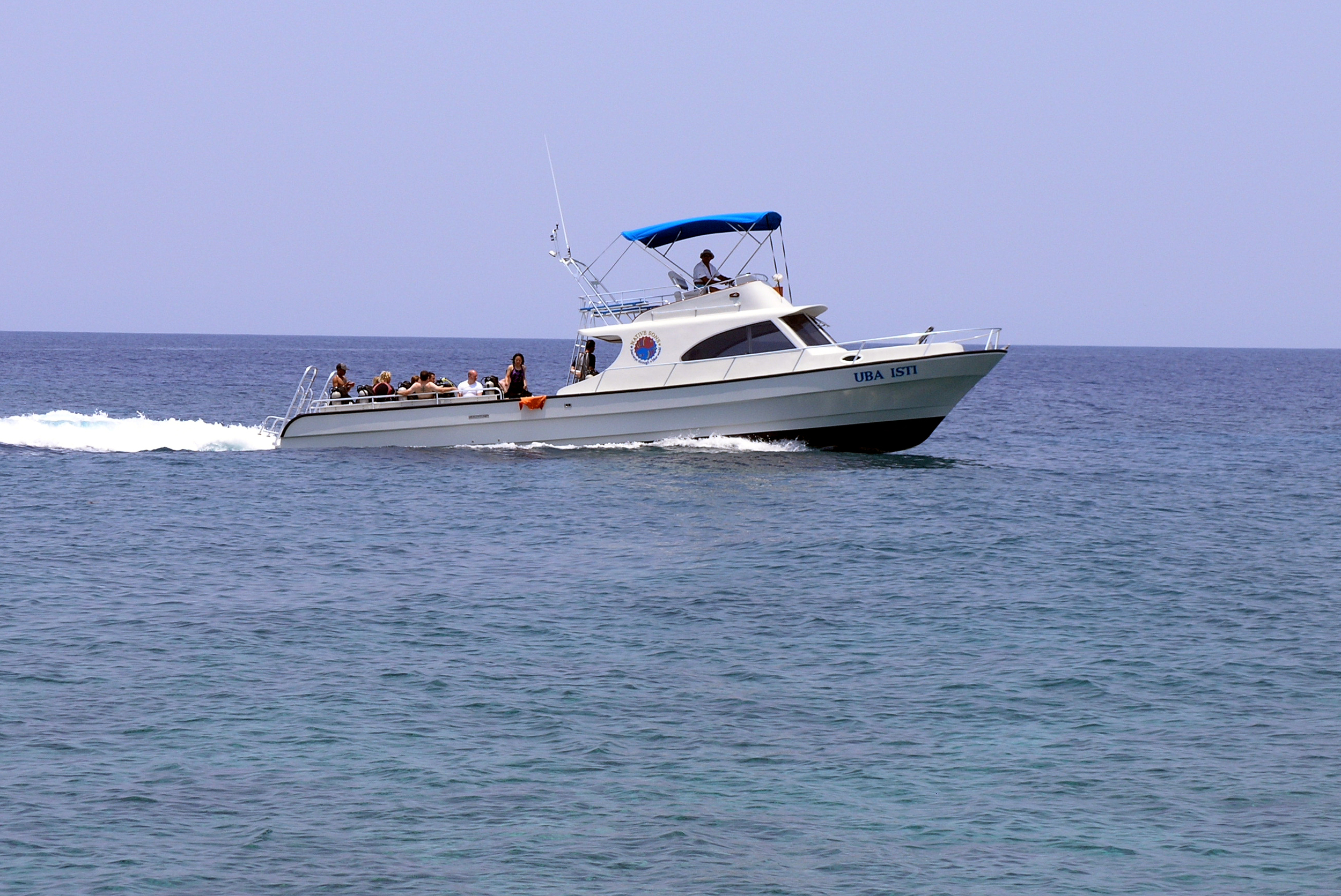 Uba Usti dive boat, the most beautiful dive boat in the Caribbean, cruising by West End.  Roatan