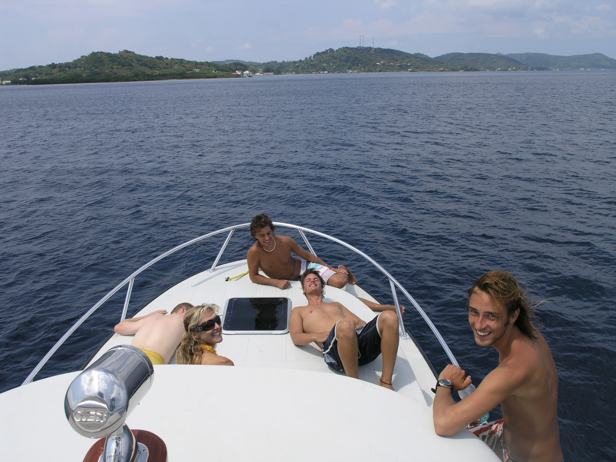Cruising Roatan, relaxing on the bow, after scuba diving.