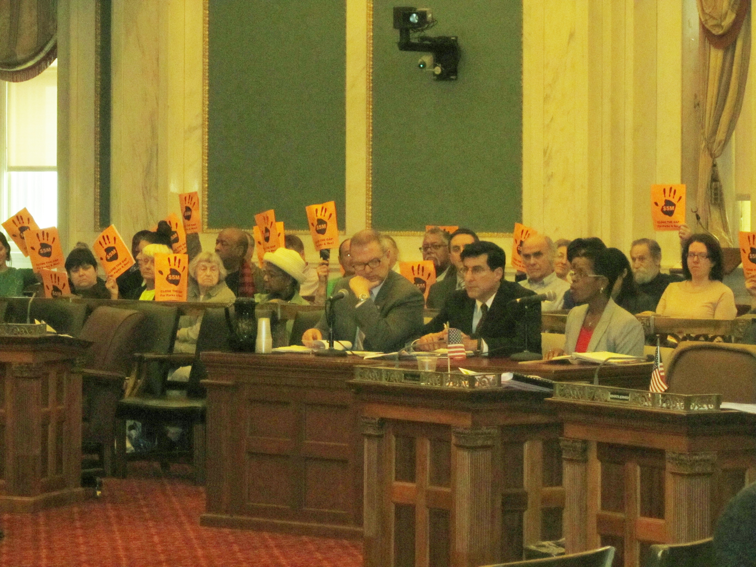 Michael DiBerardinis, Mark Focht, and Susan Slawson speak at a City Council Budget Hearing