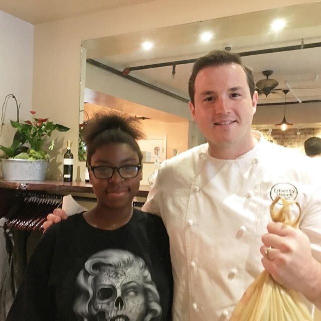 The Farm's first sale!! Roedasia Hargrove sold garlic scapes to Chef Mike at Liberty Street Bistro. Great work Roedasia!!