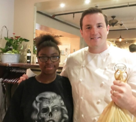 First sale of Downing Park Urban Farm products! - Roedasia Hargrove selling Garlic Scapes grown at the Farm to Chef Mike at Liberty Street Bistro