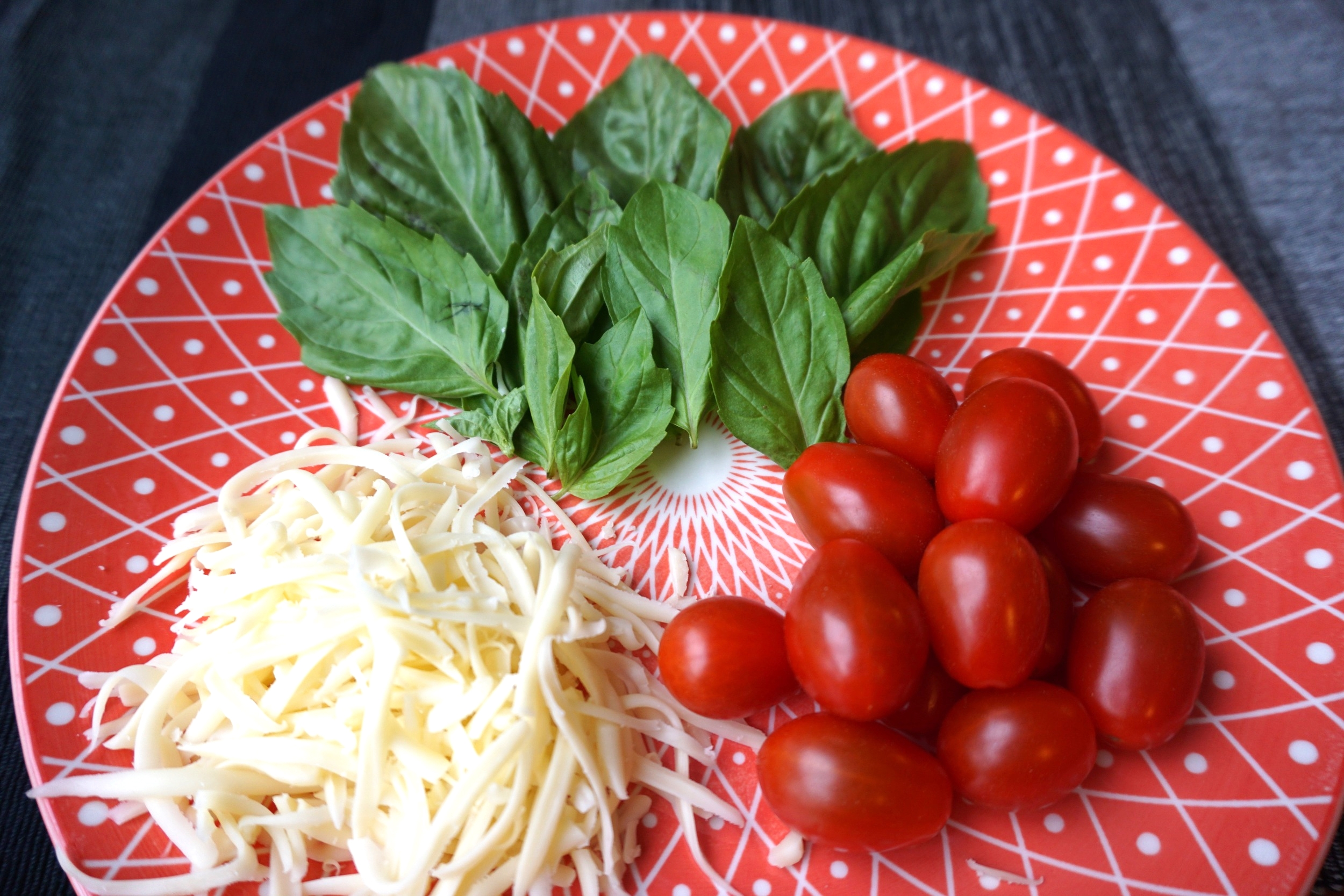 Prep your toppings! Here I have mozzarella cheese, grape tomatoes and fresh basil  (Not photographed: mushrooms, salami, olives, andcheddar cheese)