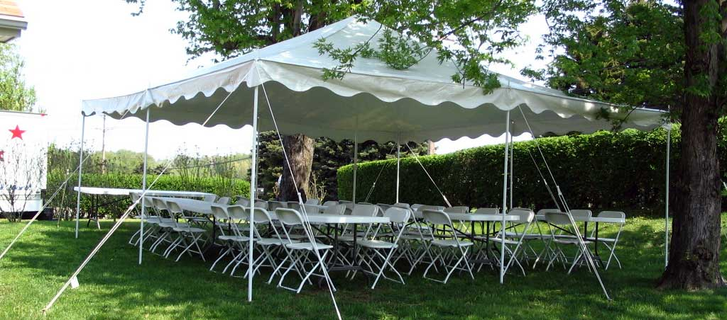 Backyard party with tent, tables & chairs.