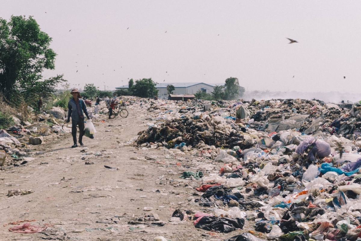 Workers in Cambodia make a living by sorting through refuse often make less than USD$2 for a day's work. They also live with their families right on the dump site.