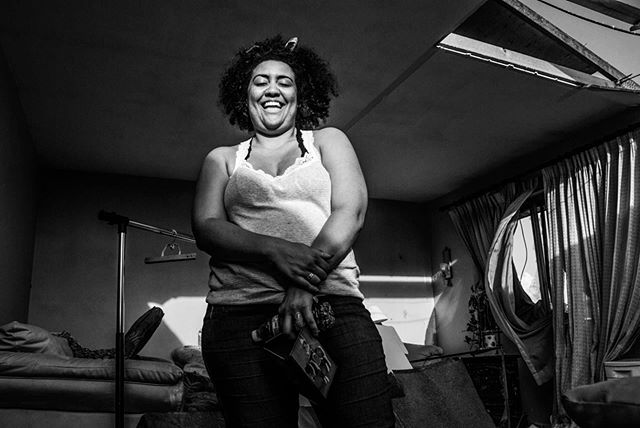 May 28, 2019, Dayton, OH—Shelter from the storm...even in darkness, a smile. Breann Donlin laughs at a friend's joke during the cleanup of what is left of her home following the 13 tornadoes that tore through Montgomery County on May 27. Photo by: Whitney Saleski for @bring_back_dayton  #dayton #daytonstrong #mom #daytonohio #ohio #midwest #photography #photojournalism #photojournalist #bnw #smile #strong #home #portrait #laugh #natgeo #yourshot #yourshotphotographer #nationalgeographic #time #life #tornado #weather #storm #shelterfromthestorm #blackandwhite