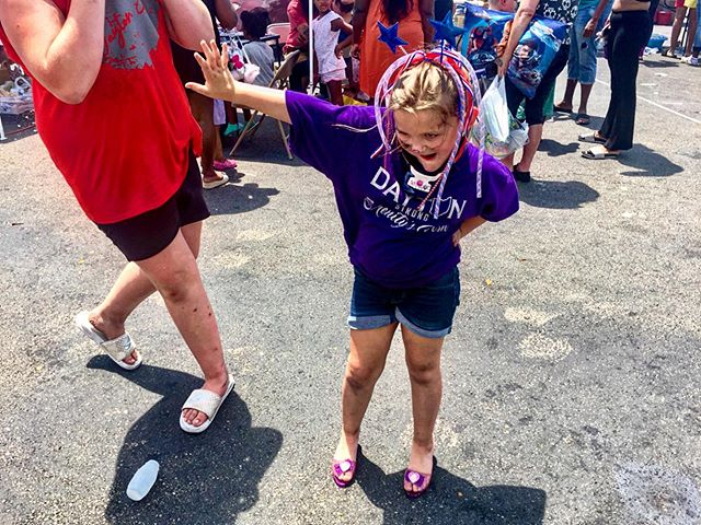 """July 14, 2019, Dayton, OH—Serenity, whose neck is in a brace following brain surgery last year, dances in a pair of borrowed heels at a Dayton tornado relief station off Main Street. She, along with her mother, Caitlin, have organized this event after Serenity witnessed the EF4 damage and remarked that she: """"knows what it feels like to lose everything."""" Photo & words by: Whitney Saleski for @bring_back_dayton  Additional information/photos: @idelamatre  #latergram #daytontornado #dayton #ohio #daytonohio #tornado #tornadoes #midwest #dance #serenity #naturaldisaster #girlgaze #usa"""