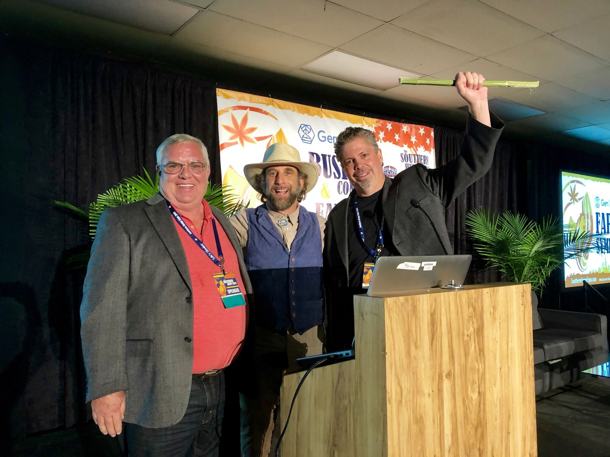 Southern Hemp Expo Co-founder Morris Beegle (right) and hemp expert and author Doug Fine (center) present a Lifetime Achievement Award to Kentucky hemp producer Craig Lee (left).