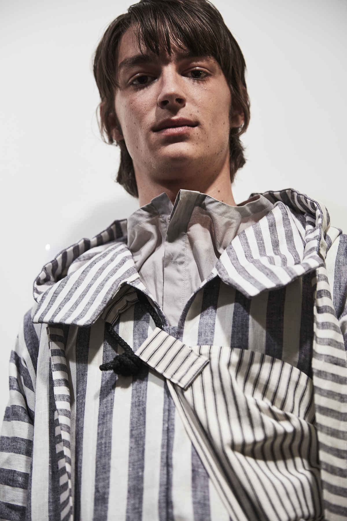 Phoebe English London Collections Men blue and white striped jacket SS17.png