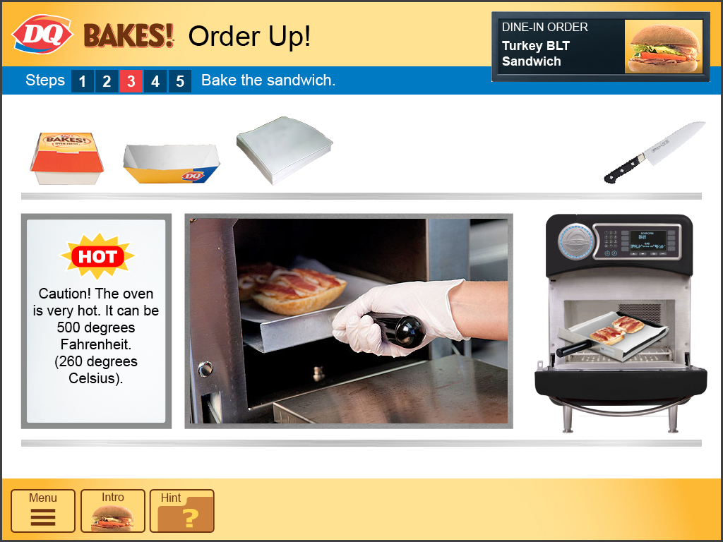 The sandwich is placed on a tray and put into the oven.