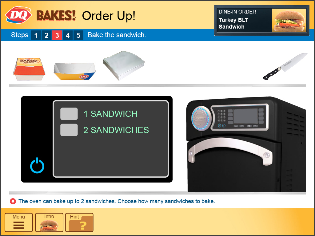 The oven is programmed for multiple products, including sandwiches. The employee presses the correct setting for one sandwich.