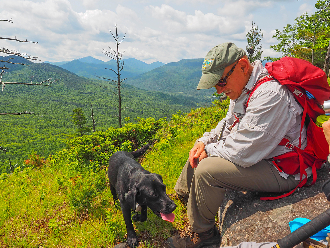 Alan's Lab, Toby, and Pat Sallese enjoying views from one of the off trail ledges.  Alan Via