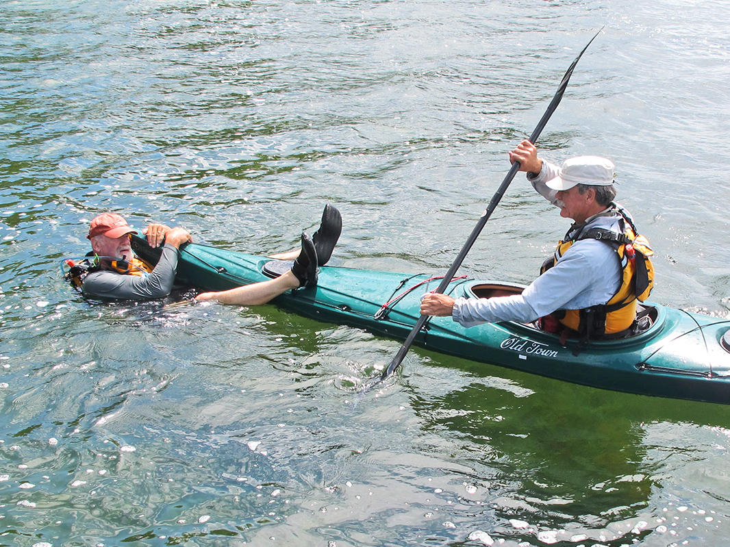 The author paddles swimmer Mike Cavanaugh to safety. Note his head is to the side of the pointy bow.