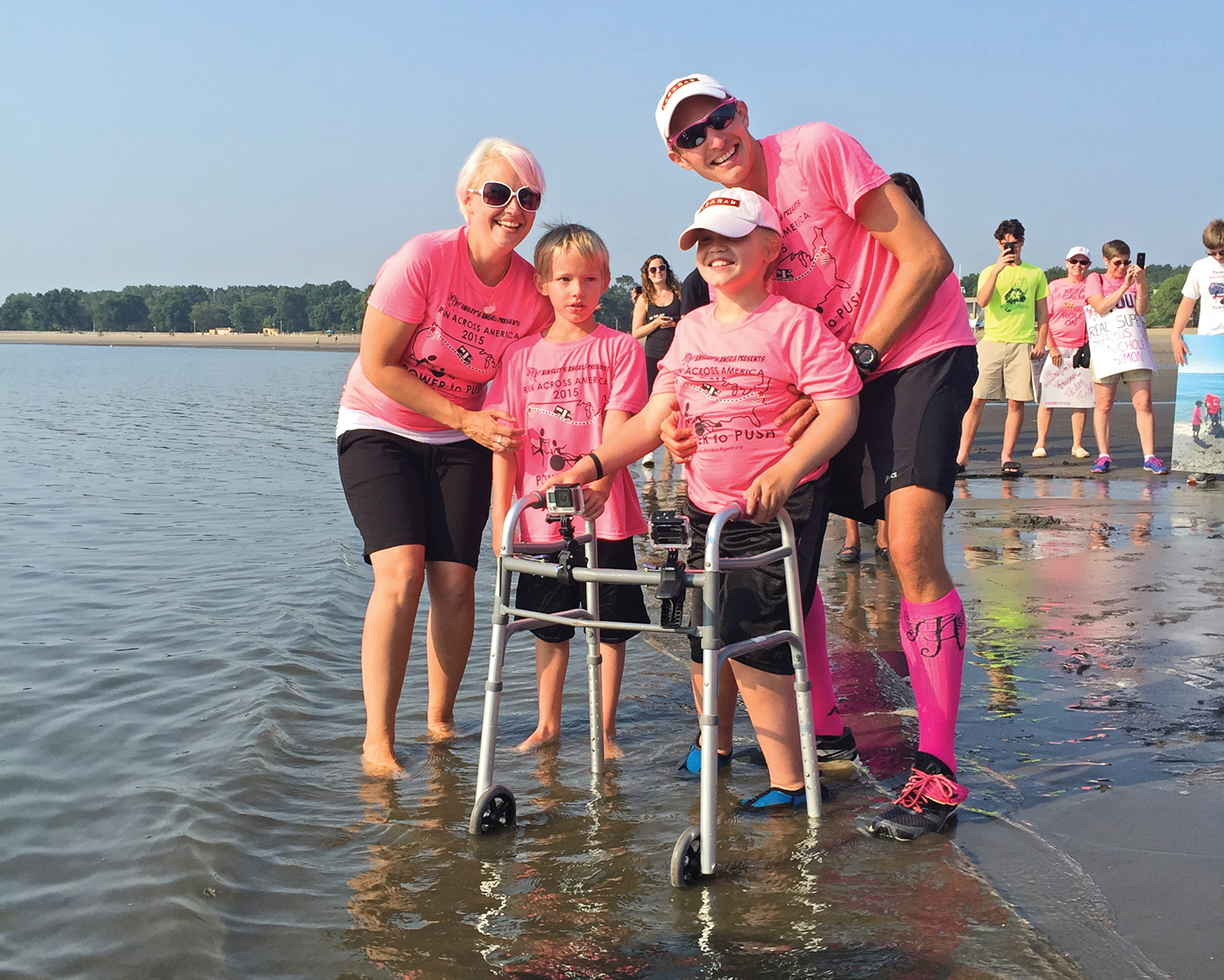 Shamus Evans and family stepping into the Atlantic Ocean, completing their amazing journey.  Photo by Jyllian Carota