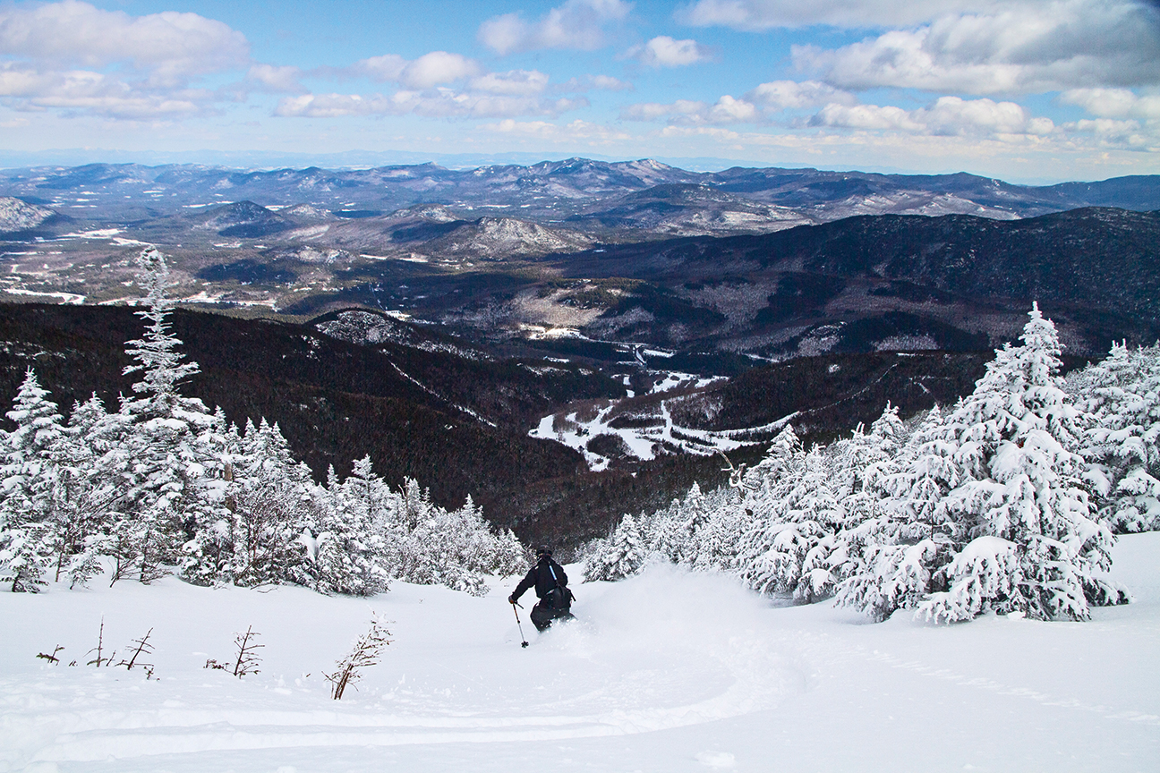 An unparalleled view of Adirondack wilderness from a slide on Whiteface.   Whiteface Mountain