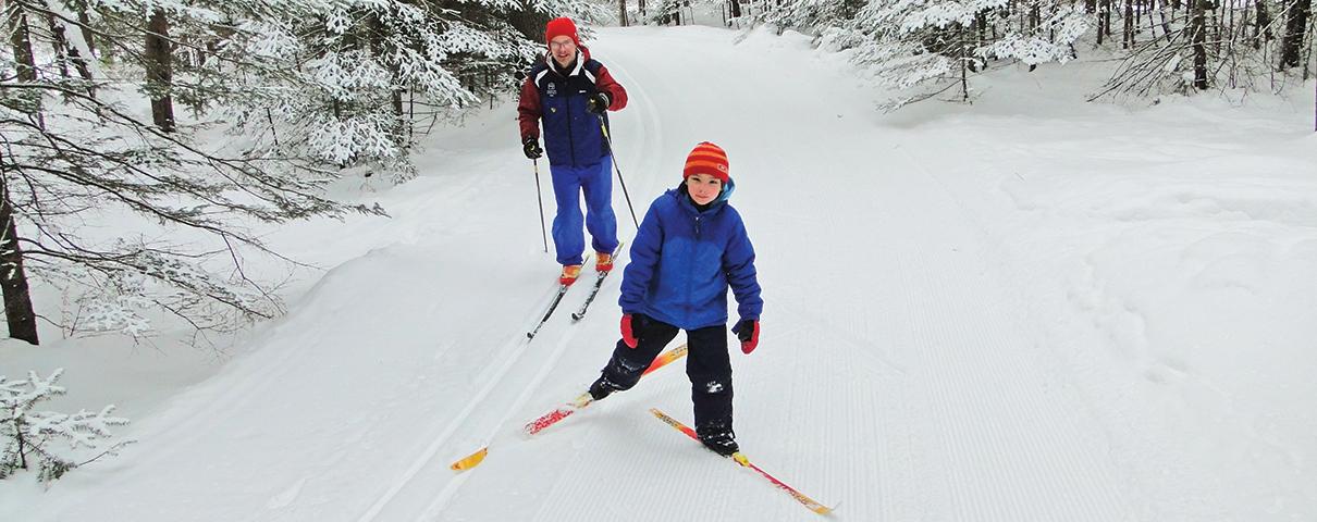 Martin Vysohlid skiing with his daughter on the Joki Latu trail at Lapland Lake.   Lapland Lake