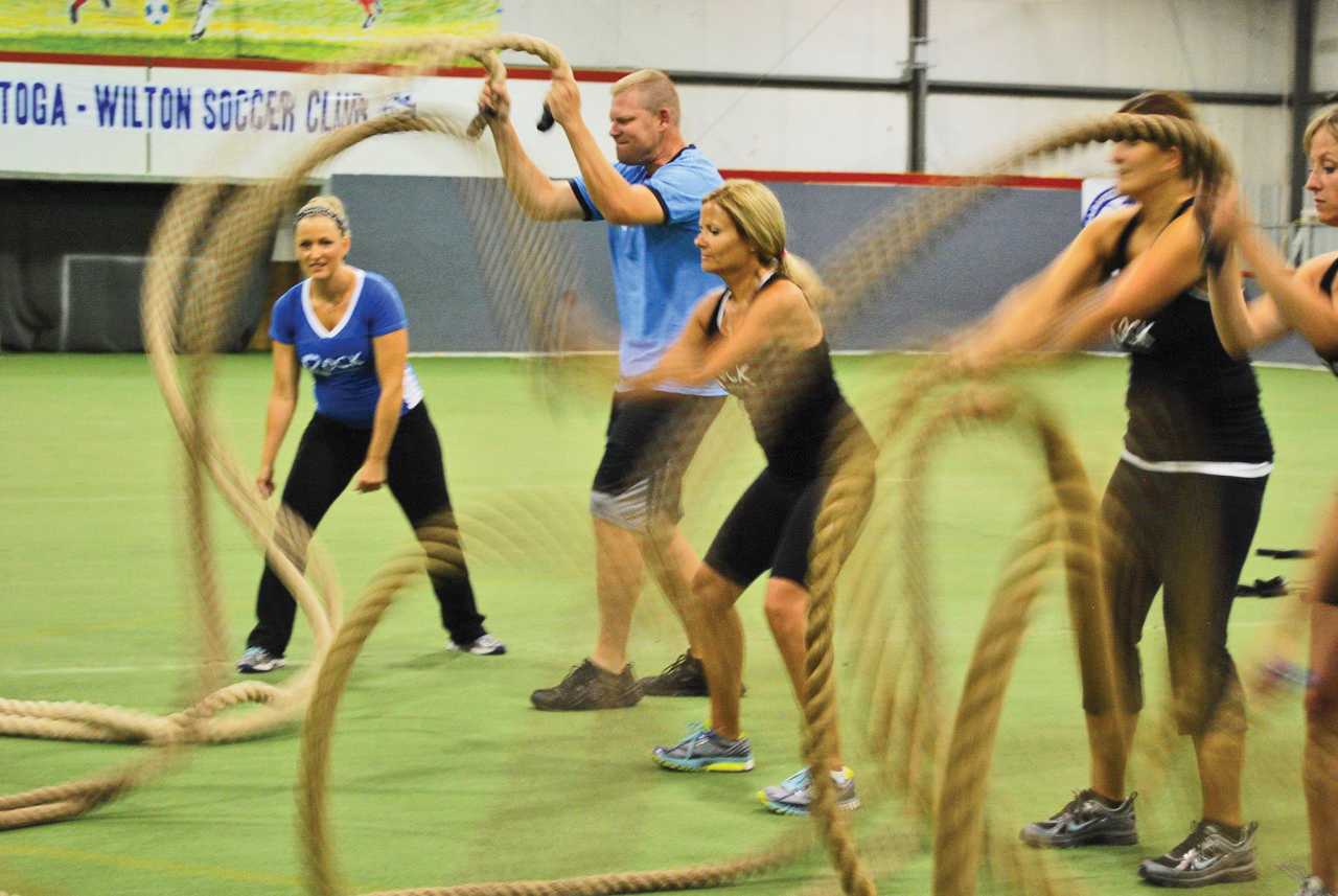 Becky Weyrauch leads battling ropes at Rock Your Fitness.
