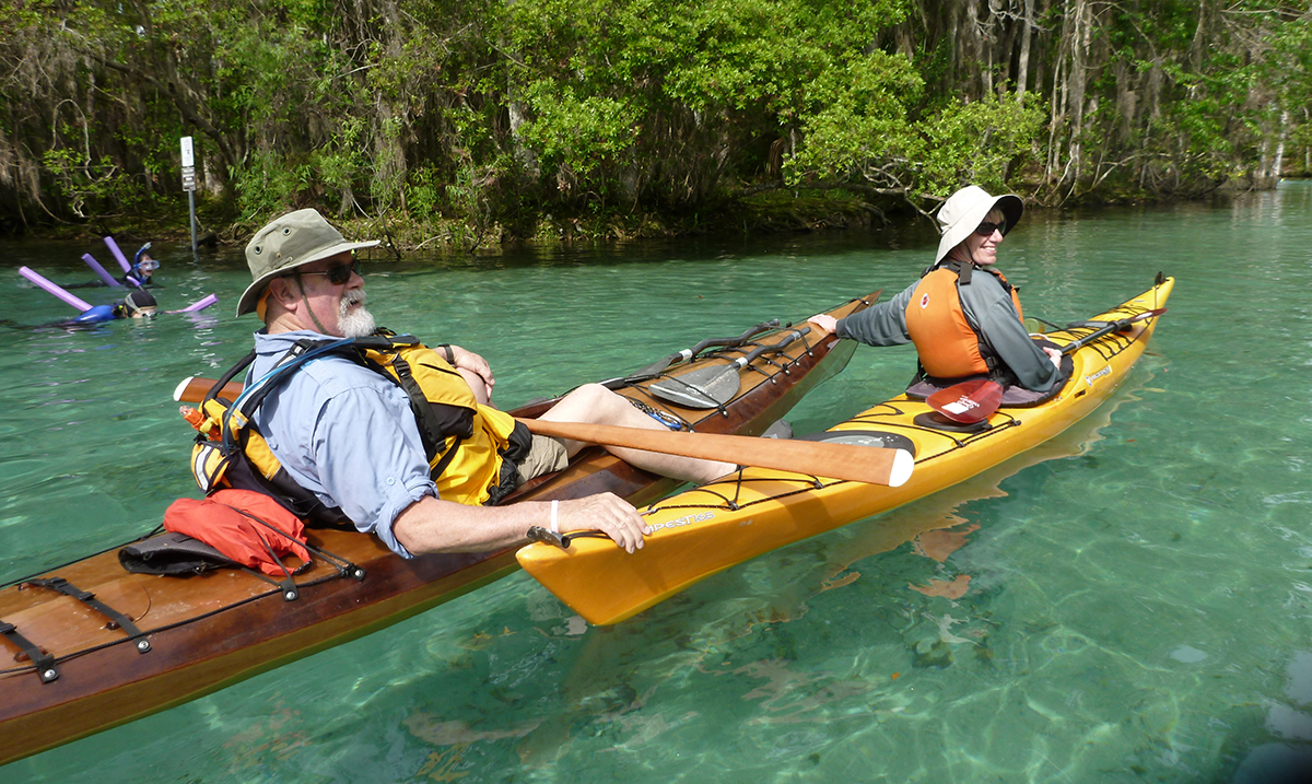 Three Sisters Spring, Crystal River, Florida: Kathy and Mike Cavanaugh enjoy the sunshine and clear water as they look for manatees.   Alan Mapes